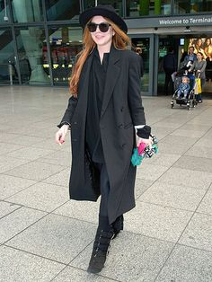 After revealing she recently had a miscarriage, Lindsay Lohan kept a low profile in an all-black outfit with a floppy hat and oversized shades in London.