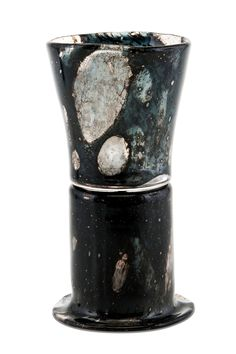 "Kaj Franck 1911-1989 A GOBLET. Signed Kaj Franck, Nuutajärvi Notsjö. Dark blueish, ""exploded"" cased glass. Height 18,5 cm."