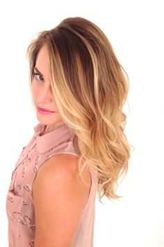 Blonde ombre. Golden blonde ends and a rich base at the roots. Beach waves.
