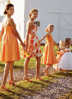My bridesmaids dresses will be deep purple, but this is a cute idea.  Especially the flowered one that I assume is the maid of honor.