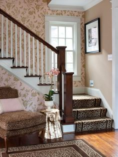 Glamorous Patterns  \Surprising animal prints and a gilded side table create a glam look near the traditional stairway. The playful mix of patterns and textures transforms an often-overlooked space into a conversation starter. This vestibule is located just beyond the home's entryway in the living room and serves as a passageway into the kitchen and family room at the back of the home.