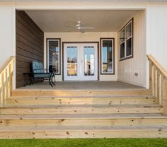 Built-in porch for your mobile home means summer drinks and evenings are on the way!