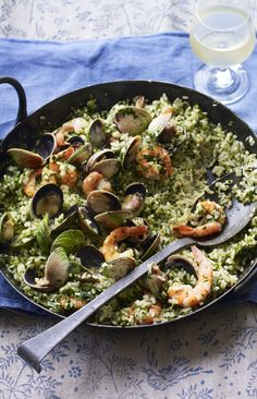 Green rice packed with seafood and lots of garlic! Crack open the white wine and get stuck in.