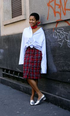 The photographer Tamu McPherson has easy weekend style in an Ermanno Scervino skirt and YSL shoes during Milan Fashion Week. (Photo: Lee Oliveira for The New York Times)