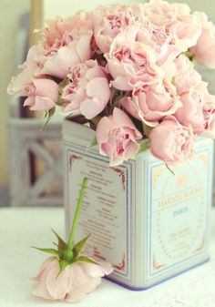 pale pink and light blue combo - loosely arranged stems in a cookie tin ... like the square tall tin... makes it a little more interesting