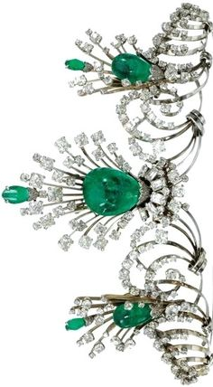 Emerald and diamond tiara designed in graduated scrolls highlighted with three sprays set with cabochon emerald drops and with rose, French-, single- and circular-cut diamonds. The emeralds detach and can be worn as earrings and a brooch, so really it's a 4-in-1. Via Diamonds in the Library.