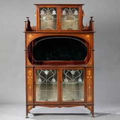 Art Nouveau Cabinet in the Manner of Shapland & Petter   Mahogany, glass, brass, copper, wood inlays  England, early 20th century  Upper cab...