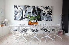 White-dining-room-with-big-graffiti-wall-art