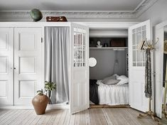 The Swedes certainly know how to do small spaces. Case in point: this small but stylish apartment, whose living room cupboard conceals a clever surprise.