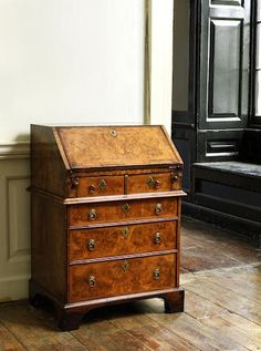 A small Queen Anne walnut, crossbanded and featherbanded bureau