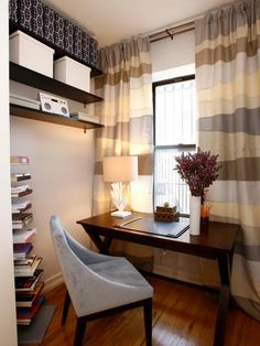 A small nook off a master bedroom became an office with a view. Storing file boxes high on shelves frees up floor space, making the room look bigger.