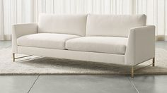 "Genesis Sofa with Brushed Brass Base | Crate and Barrel 90"" wide comes in ""strom"" (gray)"