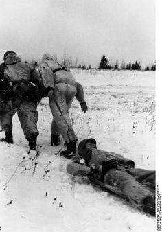 Somewhere on the Eastern front, 1941 - 44 German soldier wounded and dragged away. The German war machine became more and more ineffective and casualties mounted through 1943 - 45