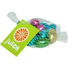 Nets of foiled milk chocolate mini eggs with a printed tag. 50g weight, approx 10 eggs.