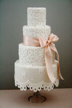 https://flic.kr/p/dVeQAw | Lace fringe wedding cake | Off white wedding cake with white lace detailing and pale peach ribbon x