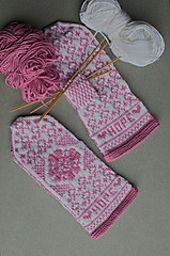 Each mitten is worked in the round. Carry yarns not in used lightly across the back of the work. Refer to the left and right mitten charts and use stitch markers to delineate side borders from the palm and back of hand patterns. White purl stitches in the design are placed only over an existing white knit stitch. Thumb stitches may be reserved on a stitch holder or scrap yarn. Be sure to try on your mitten as you work to ensure consistent fit.