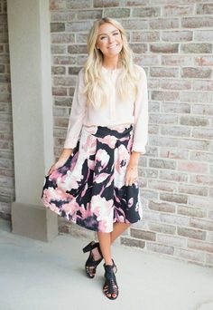 NEW ARRIVAL! This Black and Rose Floral Skirt is the prettiest skirt you ever did see! Rosey toned florals have us in love! It's the perfect A-line silhouette and length too!