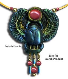 This pendant is a design created using our Egyptian Symbols mold. The scarab is of black polymer clay dusted with mica powders.