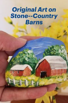 Serene country barn scene lovingly hand-painted on a smooth river stone. Rendered in acrylics and sealed with clear satin varnish for UV protection, use this piece indoors or outside. Makes a unique gift for any occasion or for Father's Day. Comes in a blue drawstring pouch for easy gift giving! Hand Painted Rocks, Painted Stones, Barn Art, Stone Barns, Red Barns, Drawstring Pouch, Friendship Gifts, Small Art, Handmade Decorations
