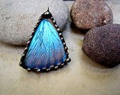 I wear my morpho butterfly pendant mostly everyday from this talented designer. Lots of compliments on this gorgeous and unique piece.