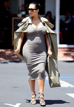 Pregnant Kim Kardashian Cradles Her Bump in Low-Cut Gray Dress - Us Weekly