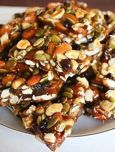 """~AUTUMN BRITTLE~  1 cup almonds 1 cup cashews 3/4 cup pumpkin seeds 2/3 cup dried cranberries 2 1/4 cups sugar  1/4 cup brown sugar 1/2 cup honey (or agave nectar) 1 cup water 1/2 tsp. salt 1 tbsp. butter"