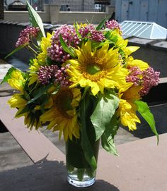 Give your appartment or office a more summery feel with a cheerful sunflower arrangement. Your NYC florist can create an arrangement for you that epitomizes #summer