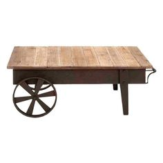 Cart-style coffee table with an aged iron frame and reclaimed wood top.   Product: Coffee tableConstruction Materi...