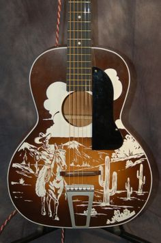 Vintage Used Guitars – 1942 Kay Del Oro Lefty Cowboy Parlor Guitar with Original Case $500.00 | Lawman Guitars Acoustic Guitar Tattoo, Acoustic Guitar Case, Guitar Solo, Guitar Art, Cool Guitar, Guitar Chords For Songs, Ukulele, Used Guitars, Instruments