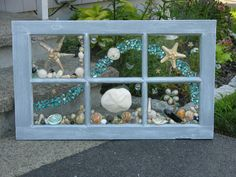 Wonderful unique beach glass and sea shell design! Starfish and Waves. Design set in re-purposed solid wood 6 light window. Design features a sea biscuit, starfish, sea shells, beach glass, sea glass, and sand dollars. Makes a gorgeous wall hanging, sun catcher, mantle display. What a fabulous gift idea