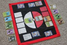 Pokemon Card Fabric Game Board: The fold up paper game board that came with my Pokémon Cards obviously was not going to last. I decided to make a fabric one that will last a long time and still be portable. Lego Pokemon, Pokemon Table, Pokemon Craft, Pokemon Room, Pokemon Themed Party, Pokemon Birthday, Pokemon Games For Kids, Diy Pokemon Cards, Pokemon Fabric