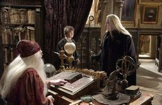 (L-r) Professor Dumbledore (RICHARD HARRIS), Harry Potter (DANIEL RADCLIFFE) and Lucius Malfoy (JASON ISAACS).