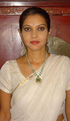 White Chamundi chiffon sari with embroidery, matching blouse, emerald pendant and Victorian emerald and diamond earrings - 2005