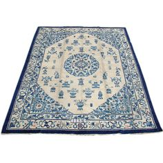 Elegant Blue Early 20th C. Peking Carpet with Classic Chinese Medallion | From a unique collection of antique and modern chinese and east asian rugs at http://www.1stdibs.com/furniture/rugs-carpets/chinese-rugs/