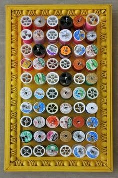 organize sewing thread on framed bulletin board and small nails
