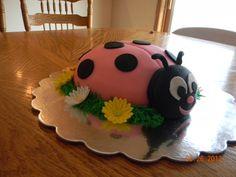 Lady bug: fondant, fondant/gum paste daisies, baked cake in a bowl