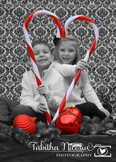 Christmas card photo ideas...black and white with a pop of focal color.  Candy cane hearts and oversized ornaments.  sibling cuteness!