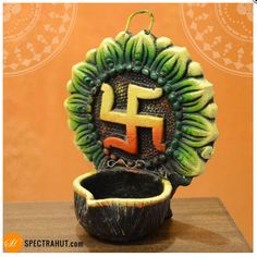 Light up your wall with this beautiful handcrafted terracotta wall hanging Diya. Perfect Decor item and ideal gift for Diwali.