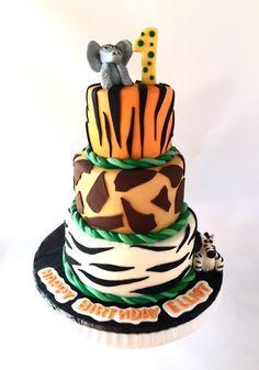 Jungle themed first birthday cake - zebra print, giraffe print, bengal tiger print