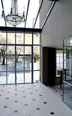 Inside a conservatory extension to a listed house, period and modern elements