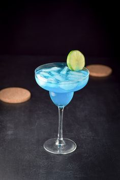 This bright and fun electric blue margarita cocktail is so delicious! I use Patron tequila and make my own sweet and sour mix! So yummy!
