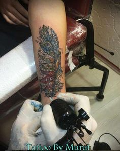 Ornate Feather Tattoo by Murat