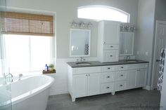 Updating a Dated Builder-Grade Master Bathroom with a pedestal tub and custom vanity