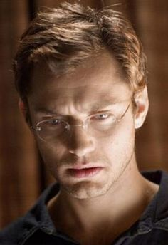 A blond Jude Law, looking scholarly. This is the man who could pass as a librarian. If you look closely it's so obvious he's a bit more deadly than that.