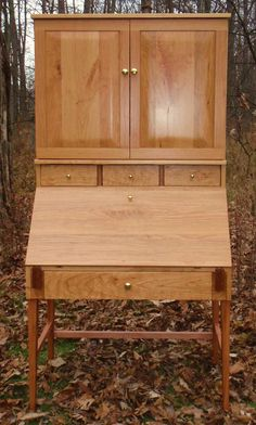 Cherry Secretary with additional top cabinet for a T.V.