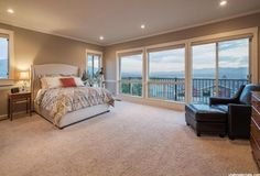 Main level master suite with direct access to a sun deck with views of the valley (Salt Lake City)