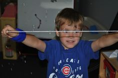 Catch bubbles on string ~ Great activity for visual planning, visual tracking, proprioception, cooperation, self control, and muscle control.