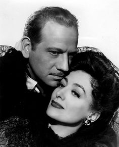 """Joan Crawford and Melvin Douglas in """"They All Kissed the Bride"""" (1942)"""