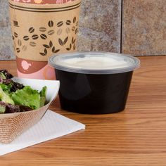 The Newspring E506B ELLIPSO 6 oz. black oval plastic<br> souffle / portion…