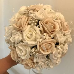 An artificial wedding bouquet featuring beige, white and ivory foam roses Bride Bouquets, Bridesmaid Bouquet, Artificial Wedding Bouquets, Pearl Decorations, Foam Roses, Shades Of White, Satin Bows, Ivory, Beige
